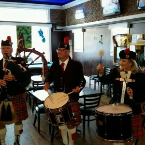 Men and Woman Playing Bagpipes at the Bar